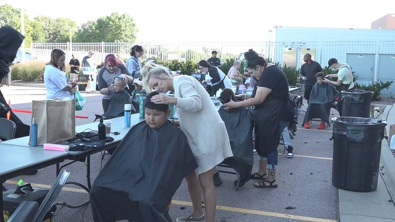 Local businesses give free haircuts to kids as back to school draws closer