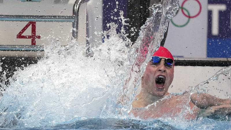 Adam Peaty of Great Britain celebrates after winning the final of the men's 100-meter...