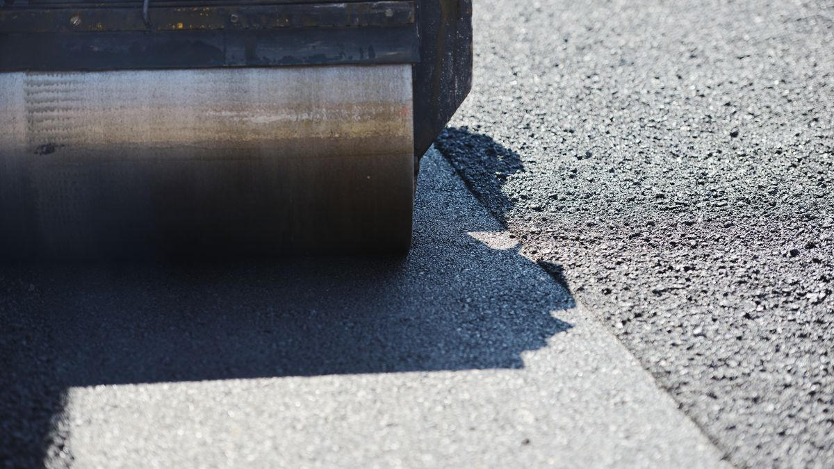 Men hard working on asphalting road