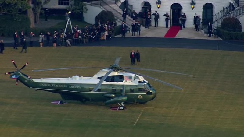 President Donald Trump and First Lady Melania walk out of the White House for the last time....