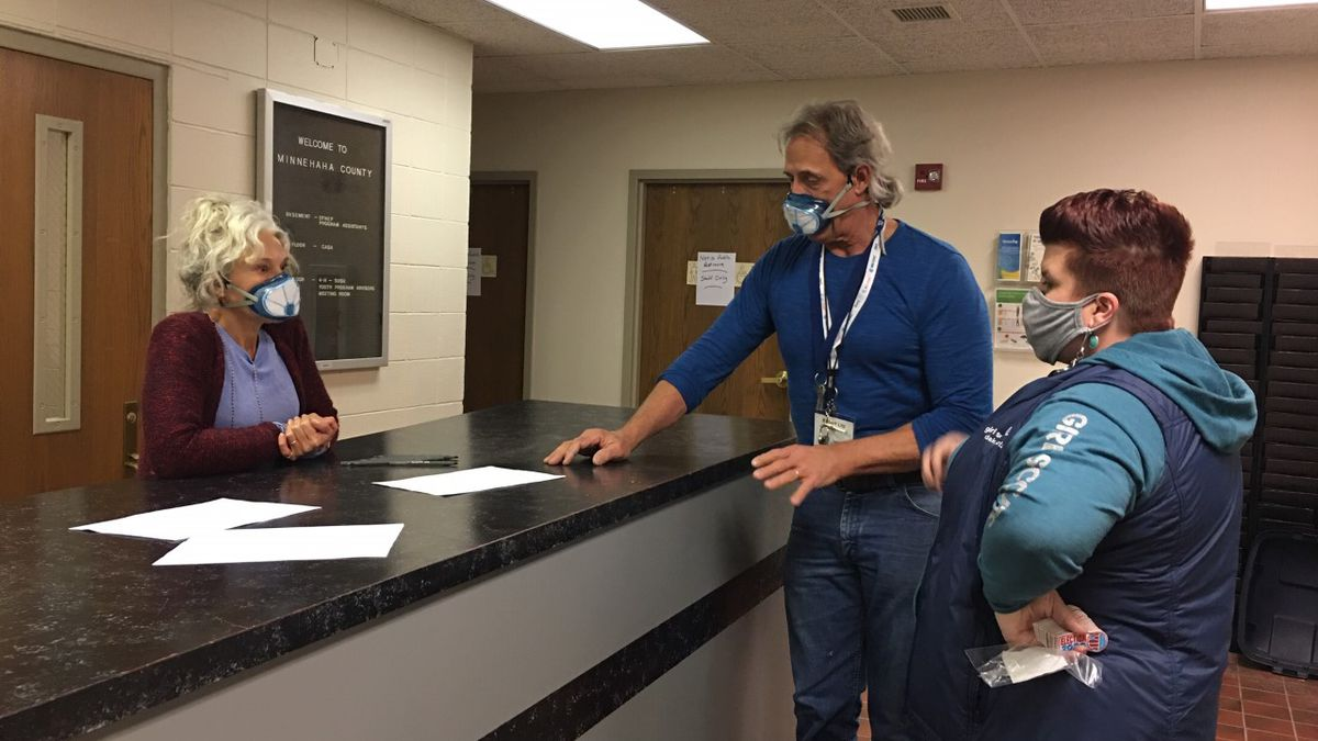 Bob Litz working at the Minnehaha County election center on election day. He was diagnosed with...