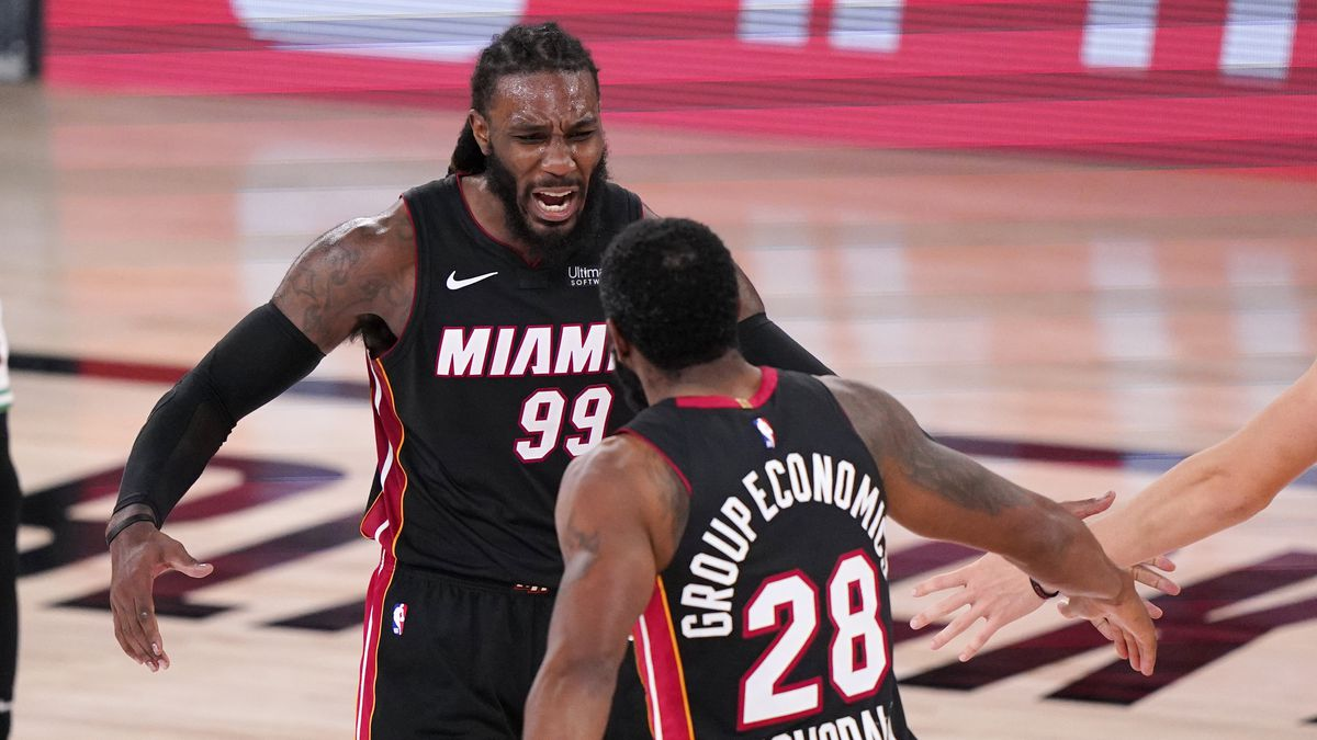 Miami Heat's Jae Crowder (99) and teammate Andre Iguodala (28) celebrate a basket during the second half of an NBA conference final playoff basketball game against the Boston Celtics Sunday, Sept. 27, 2020, in Lake Buena Vista, Fla.