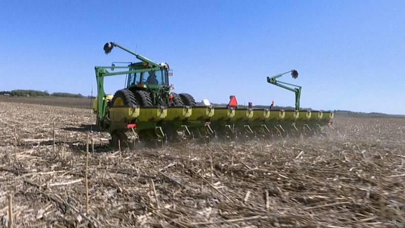 Jeff Thompson, a corn and soybean farmer, works in a field near Lyons, SD.