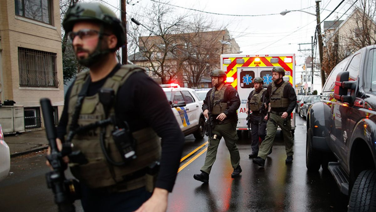 Police officers arrive at the scene following reports of gunfire, Tuesday, Dec. 10, 2019, in Jersey City, N.J. (AP Photo/Eduardo Munoz Alvarez)