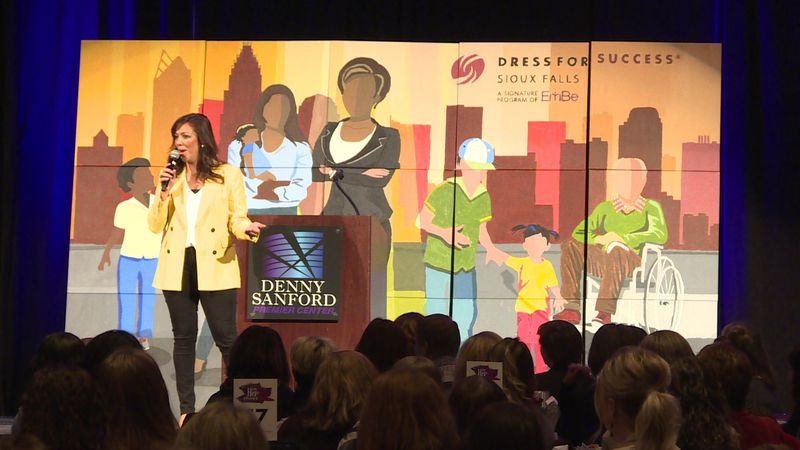 This photo captures the In Her Shoes Empowerment Breakfast in 2018.