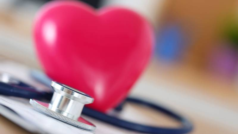 44914374 - medical stethoscope head and red toy heart lying on cardiogram chart closeup....