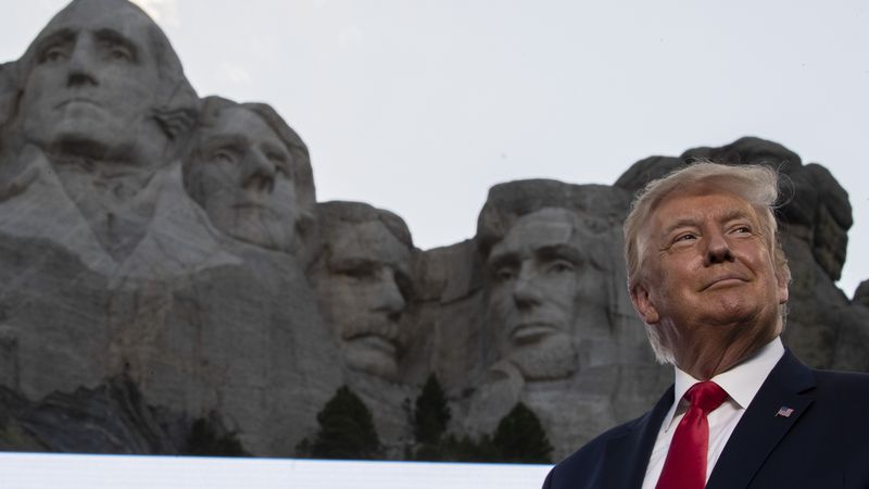 FILE - In this July 3, 2020, file photo, President Donald Trump stands at Mount Rushmore...