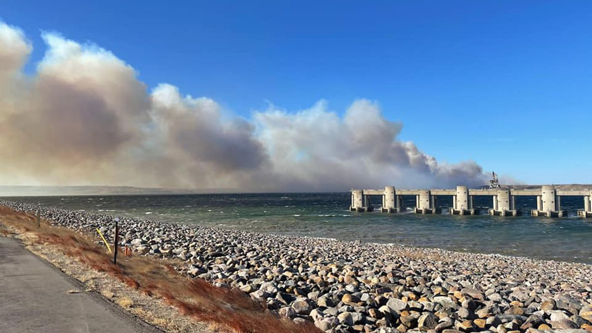 A plume of smoke towers over the Oahe Dam as crews battle a prairie fire on Jan. 14.