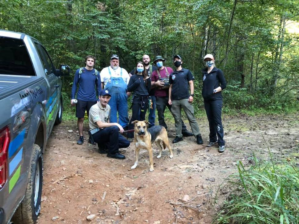 A group of mountain bikers on a North Carolina trail spotted a dog trapped 30 feet (9 meters) down in a sinkhole — and it took a salty snack and some straps to lift him to safety.