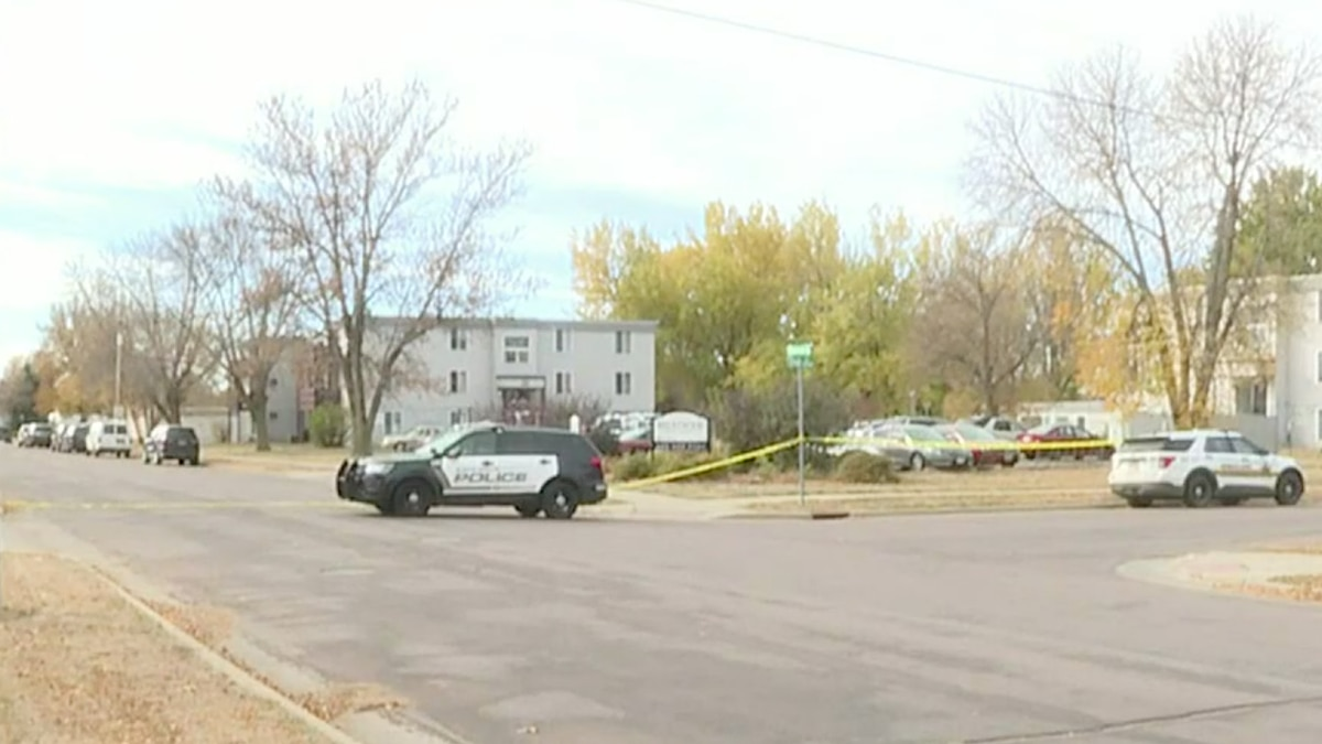 Police investigate the scene the day after a fatal officer-involved shooting in Sioux Falls.