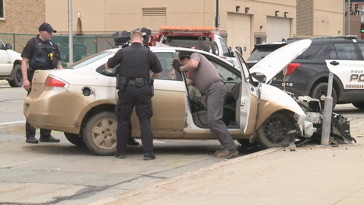 Police arrested a Sioux Falls woman Friday after she tried to strike an officer with her car.