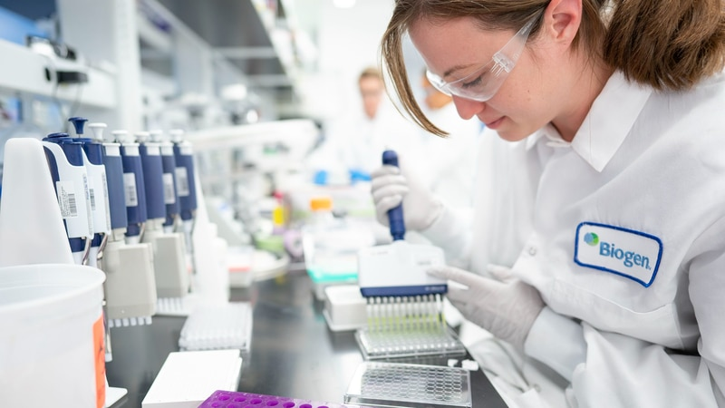 In this Dec. 12, 2019 photo provided by Biogen, a scientist works on Alzheimer���s disease...