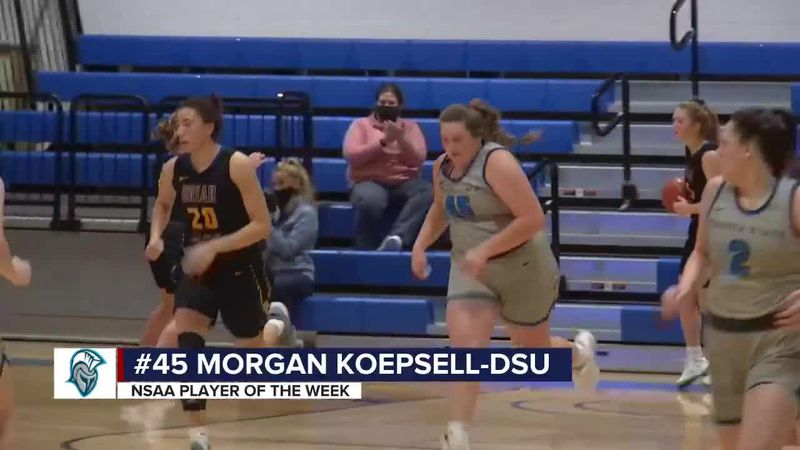 Koepsell and Giles enjoying the success of their hometown team at Dakota State